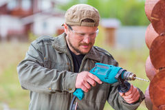 Worker with a drill Royalty Free Stock Image
