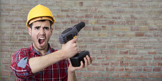 Worker with drill screaming Royalty Free Stock Images