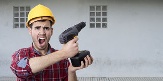 Worker with drill screaming Royalty Free Stock Photography