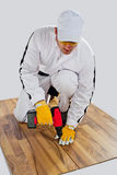 Worker drilled wooden floor cracks Stock Image