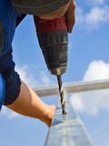 Worker drilling closeup Royalty Free Stock Images