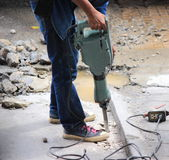 Worker are drilling concrete floor. Stock Photos