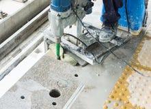 Worker drilling floor Stock Images