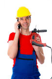 Worker with drilling machine is calling. Worker with drilling machine up in red shirt is calling Stock Images