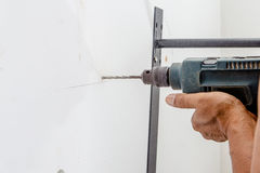Worker drilling Stock Image