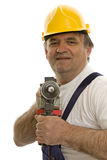 Worker with drilling machine and safety helmet Royalty Free Stock Photo