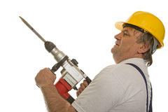 Worker with drilling machine and safety helmet. Isolated against a white background Royalty Free Stock Photos
