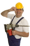 Worker with drilling machine and safety helmet. Isolated against a white background Royalty Free Stock Photography