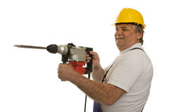 Worker with drilling machine and safety helmet. Isolated against a white background Royalty Free Stock Photo