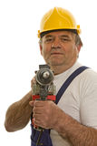 Worker with drilling machine and safety helmet. Isolated against a white background Royalty Free Stock Images