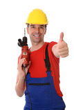 Worker with drilling machine and thumb up Royalty Free Stock Photography