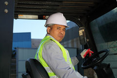 Worker driver of a forklift. At warehouse Royalty Free Stock Image