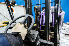 Worker driver of forklift stock image