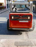 Worker driver Skid steer remove Worn Asphal Royalty Free Stock Photo
