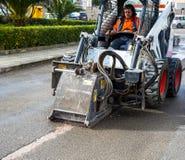 Worker driver Skid steer remove Worn Asphalt Royalty Free Stock Photo