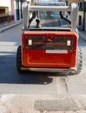 Worker driver Skid steer remove Worn Asphalt Stock Photography