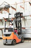 Worker driver at warehouse forklift Stock Photos