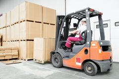 Worker driver at warehouse forklift Royalty Free Stock Image