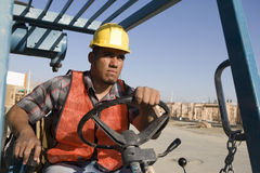 Worker Driving Bulldozer At Site Stock Images