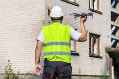 Worker with drone before hand launch Royalty Free Stock Image