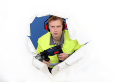 Worker with ear muffs Stock Photography