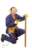 Worker in ear muffs with drill and board Stock Photos