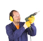 Worker in ear muffs and glasses with drill. Royalty Free Stock Photos