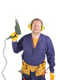 Worker in ear muffs and glasses with drill. Royalty Free Stock Images