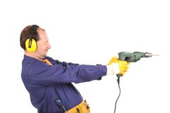 Worker in ear muffs and glasses with drill. Royalty Free Stock Photography