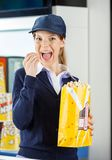 Worker Eating Popcorn At Cinema Concession Stand Royalty Free Stock Photo