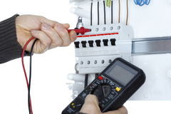 Worker with electrical tester. Is working on distribution board Stock Image