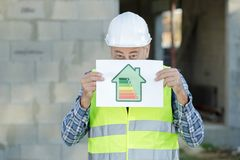 Worker with energy rating sign. Worker with an energy rating sign royalty free stock images