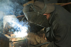 Worker is engaged in welding Stock Image