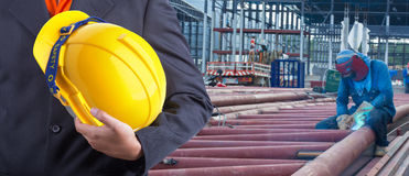 Worker or engineer holding in hands yellow helmet Stock Photo