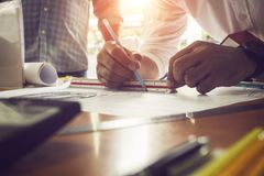 Worker engineer housing plan architect drawing paper of structure. White shirt stock images