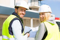Worker and enginner checking last details before delivery Royalty Free Stock Photo