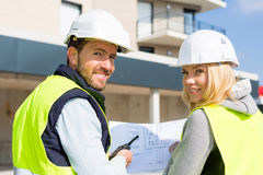 Worker and enginner checking last details before delivery Royalty Free Stock Image