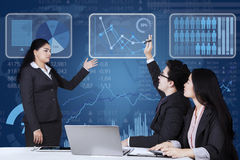 Worker enquiring on the manager. Male employee raising hand and inquiring on his manager when meeting together in the office Stock Image