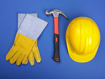 Worker equipment - HardHat Hammer And Gloves Royalty Free Stock Image