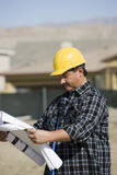 Worker Examining Blueprints Royalty Free Stock Images
