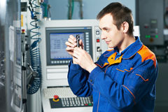 Worker examining detail Royalty Free Stock Images