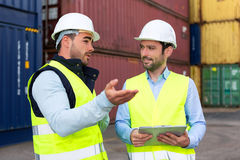 Worker explains to supervisor security system setting up Royalty Free Stock Photos