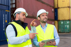 Worker explains to supervisor security system setting up Stock Image