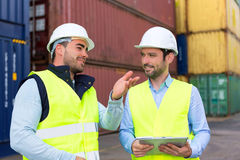 Worker explains to supervisor security system setting up Royalty Free Stock Images