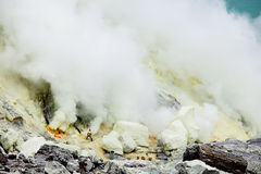 Worker extract the sulfur from active volcano Stock Photography