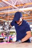Worker fabric cutter Stock Photos