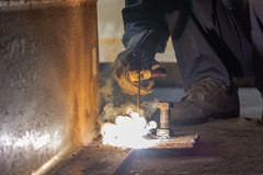 Worker fabricate structure by Shield Metal Arc Welding process Stock Images