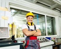 Worker in a factory control room Royalty Free Stock Image