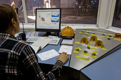 Worker in factory control room Royalty Free Stock Images