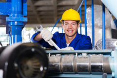 Worker in factory. Happy modern blue collar worker in factory Royalty Free Stock Image